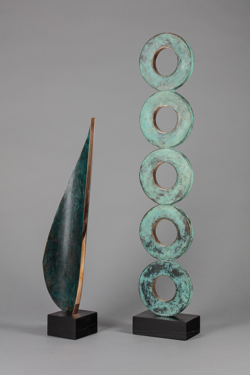 (Left) Everything You Want AP I, Bronze on slate base, 18x3x3'', £1900 by  Chris Buck